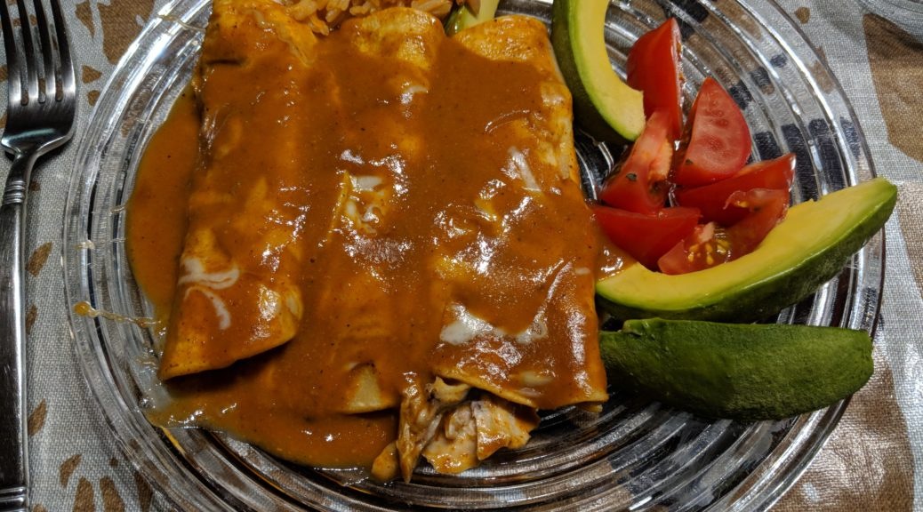 Chicken enchiladas with a little garnish on the side